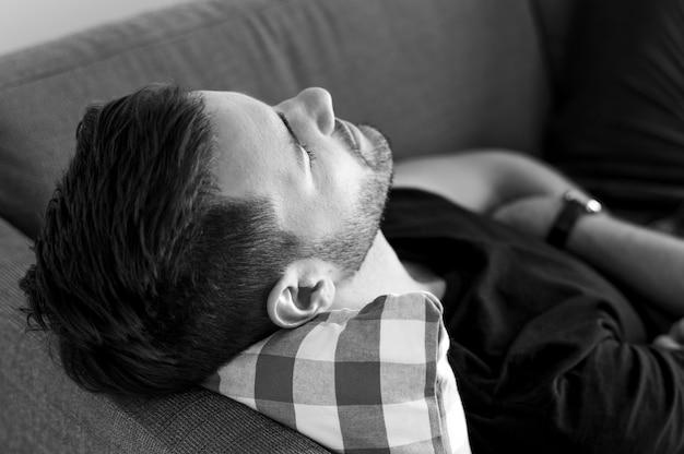 Man sleeping on the sofa Free Photo
