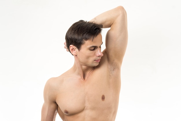 Man smelling his armpit with white background Free Photo