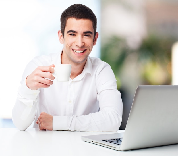 Man Smiling And Holding A Cup Of Coffee Photo