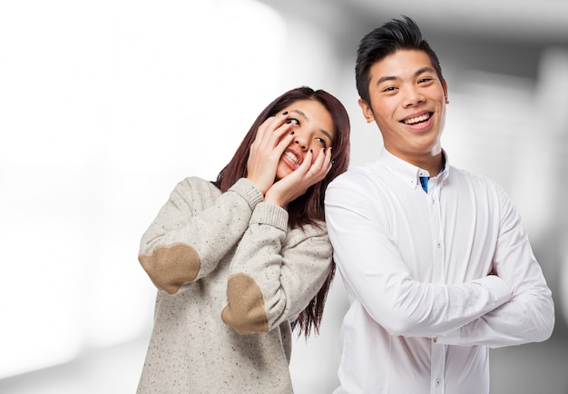 Man smiling and woman clutching his face 1187 1024
