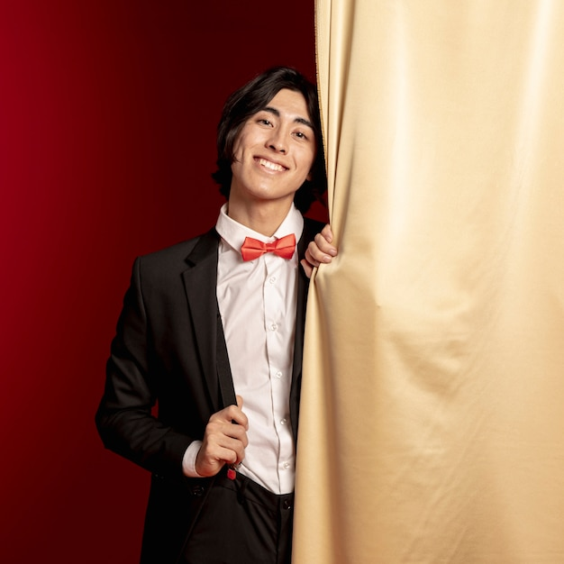 Man smiling in suit for chinese new year Free Photo