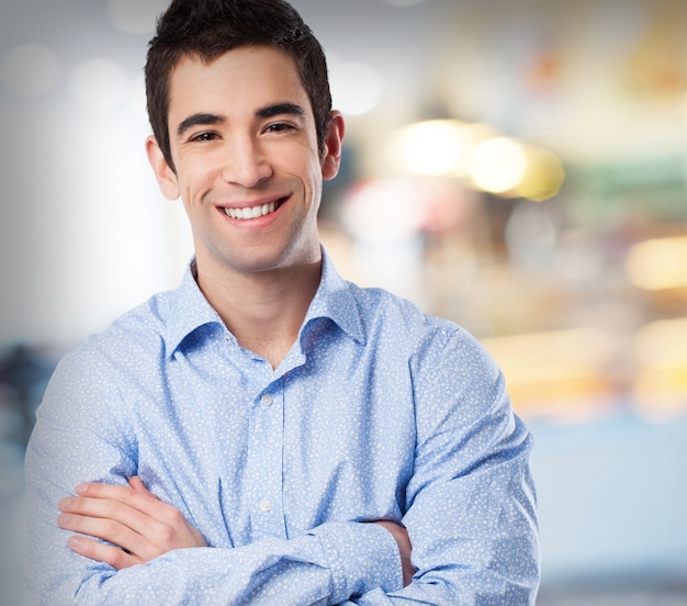 Man smiling with arms crossed Free Photo