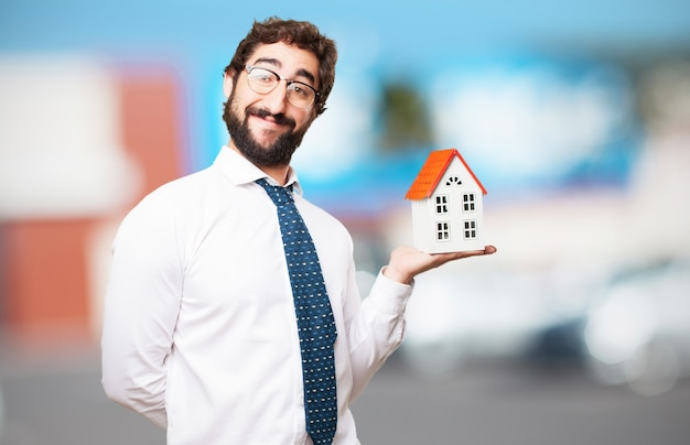 Man smiling with a house in his hand Free Photo