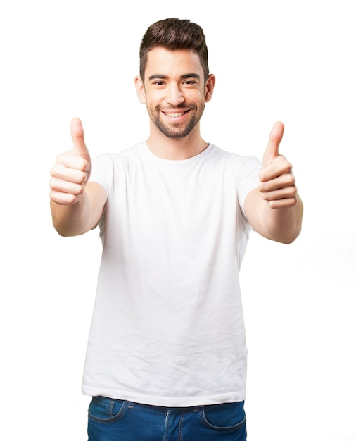 Man smiling with thumbs up | Free Photo