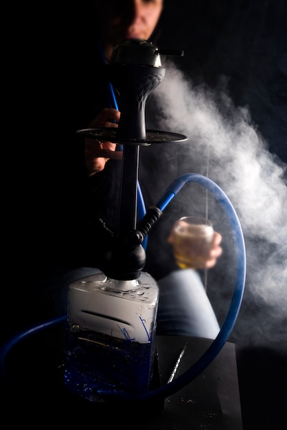 Man smokes fruit hookah Premium Photo