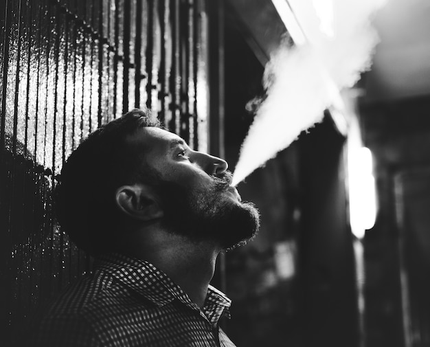 Man smoking grayscale Free Photo