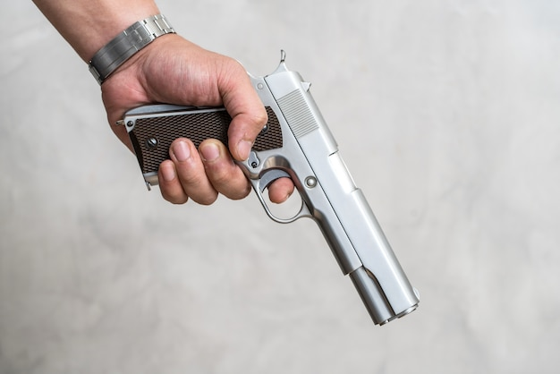 A man standing on a criminal with a gun in his hand. Premium Photo