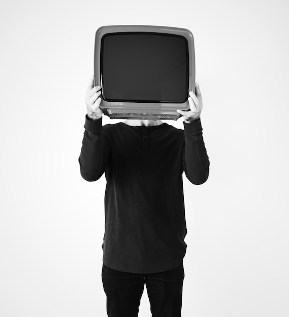 Man standing and holding a tv Free Photo