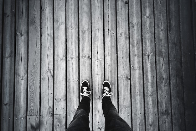 Man standing on the old wooden floor. Free Photo