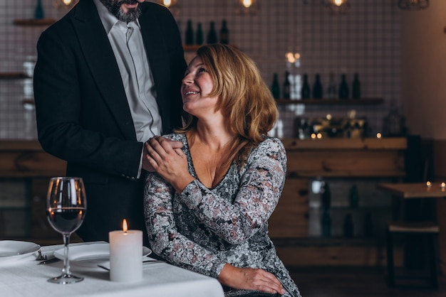 Premium Photo | Man stands behind a woman with his hand on her shoulder