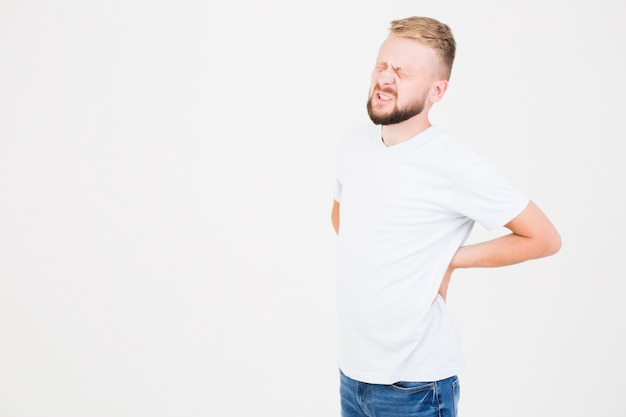 Man suffering from backache Free Photo