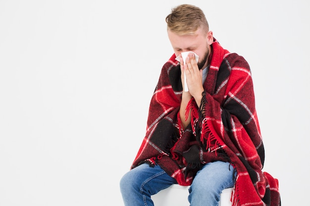 Man suffering from cold Free Photo