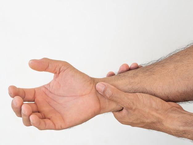 Man suffering from pain in hand. Premium Photo