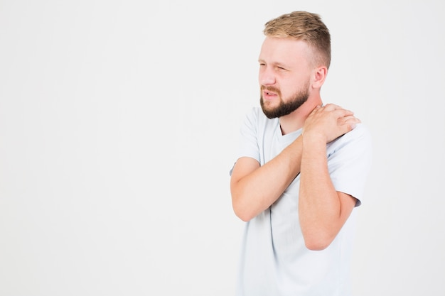 Man suffering from pain in shoulder Free Photo