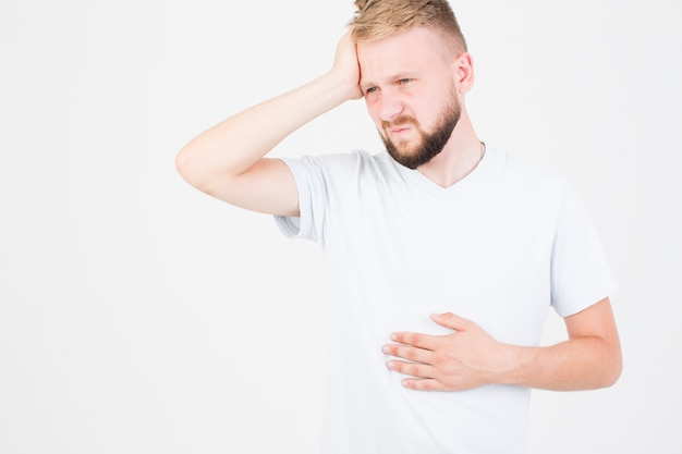 Man suffering from pain Free Photo