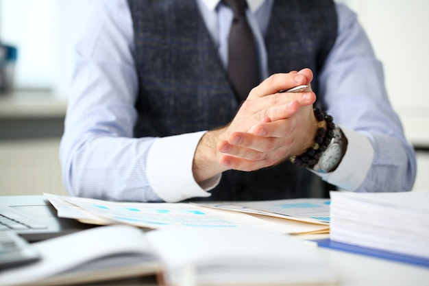 Man in suit clap his arms congrats for successful seminar in office closeup. great news lecture speech job emotion worker introduce colleague negotiation happy birthday win career project idea Premium Photo