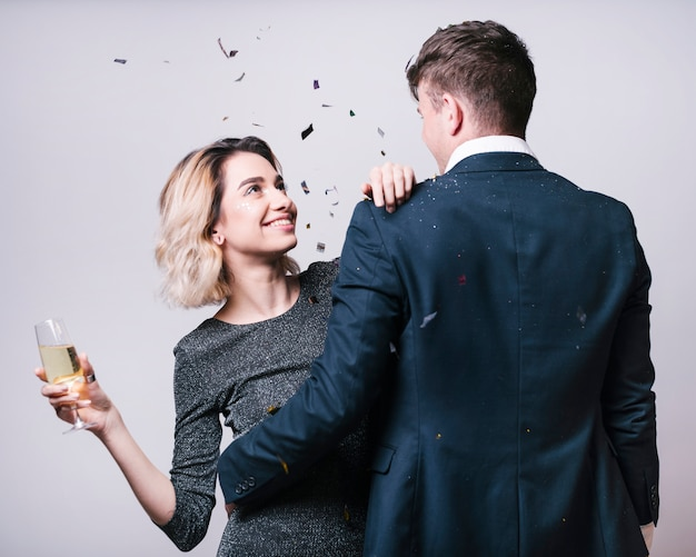 Man in suit looking at woman with champagne glass Free Photo