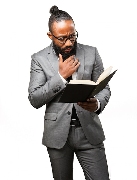 Man in suit reading a book Free Photo
