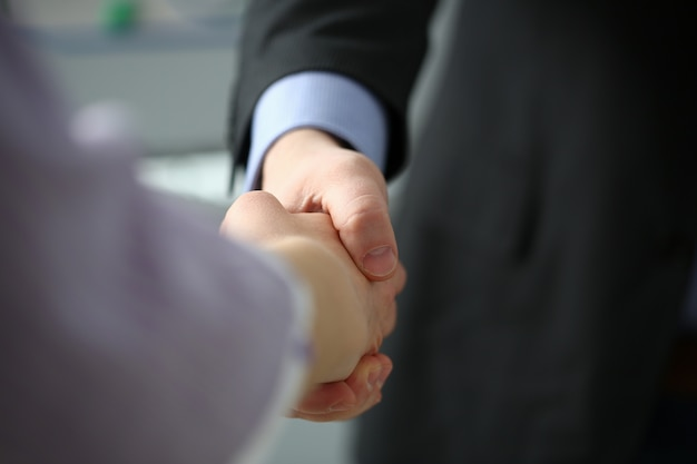 Man in suit and tie give hand as hello in office closeup. friend welcome mediation offer positive introduction thanks gesture summit participate executive approval motivation male arm strike bargain Premium Photo