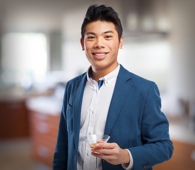 Man in suit with a drink in his hand Free Photo