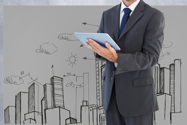 Man in suit with a tablet and background of a city drawn Free Photo