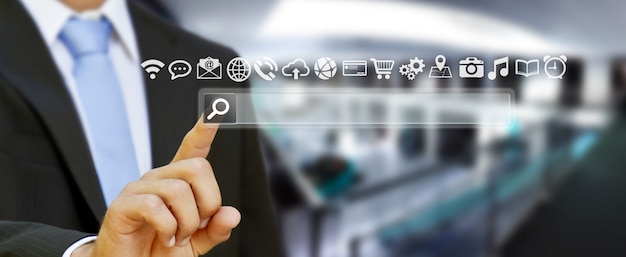 Man surfing on internet with digital tactile web address bar Premium Photo