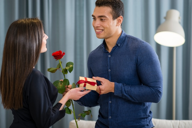 Man surprising his girlfriend with a cute gift Free Photo