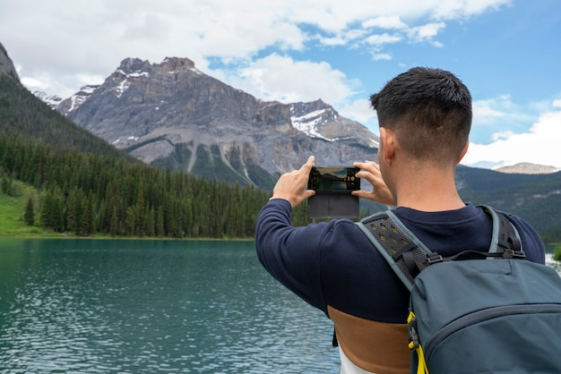 A man taking a picture to the mountains Premium Photo