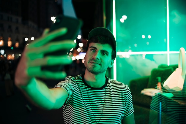 Man taking a selfie in the night Free Photo