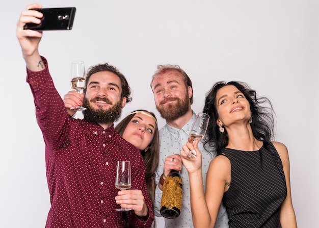 Man taking selfie with friends on party Free Photo