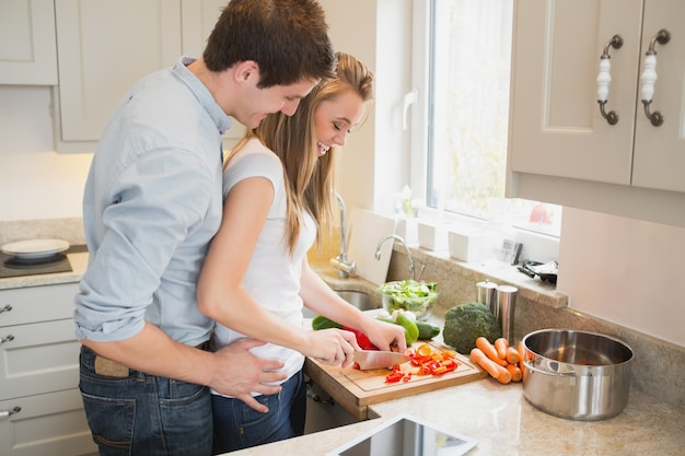 Man talking with woman while cooking Premium Photo