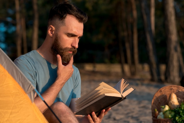 Man thinking and reading a book Free Photo