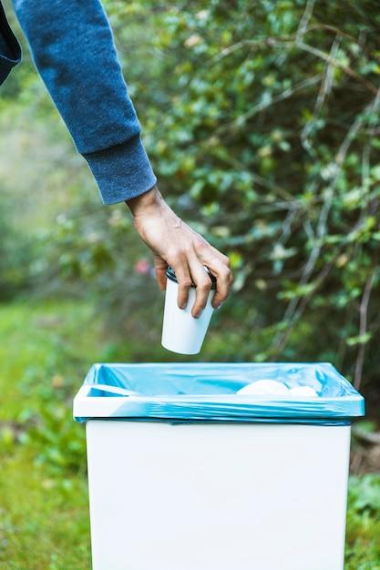 Man throwing up garbage in bin | Free Photo
