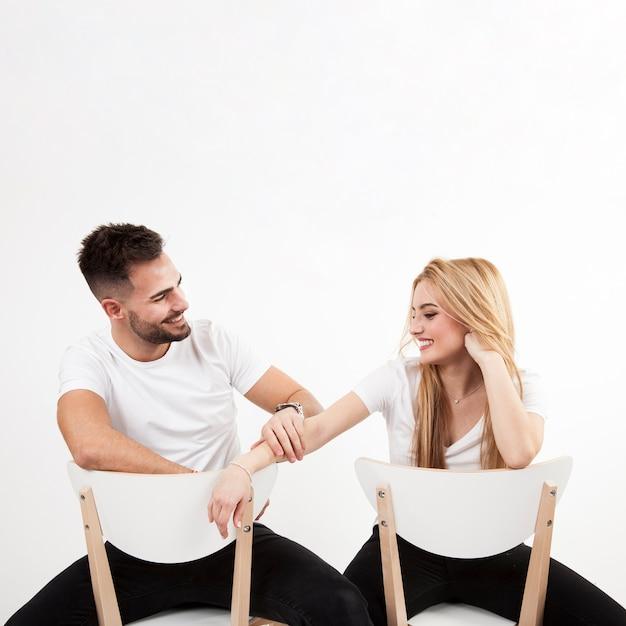 Man touching arm of woman | Free Photo
