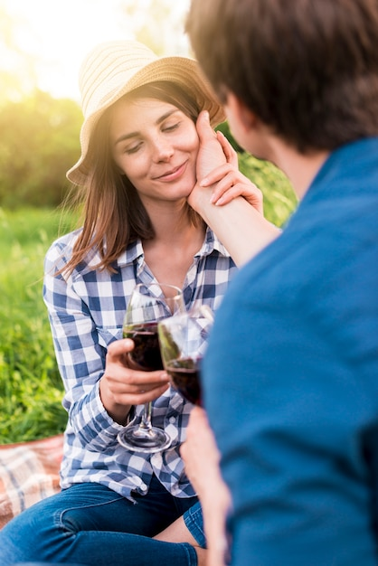 Man touching face of girlfriend gently on picnic Free Photo