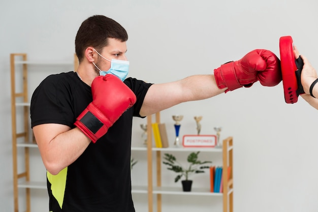 Man training for a box match Free Photo