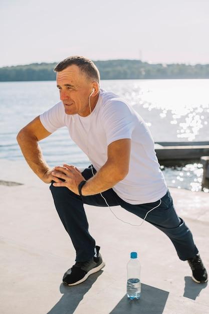 Man training near a lake Free Photo