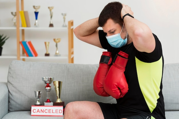 Man training while wearing a medical mask indoors Free Photo