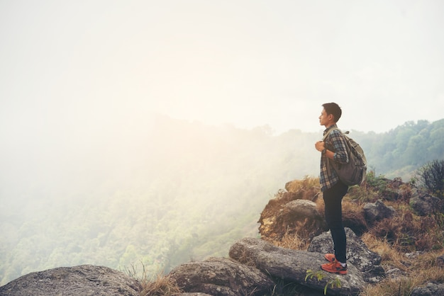 Man traveler with backpack on top of mountain. travel lifestyle concept. Free Photo