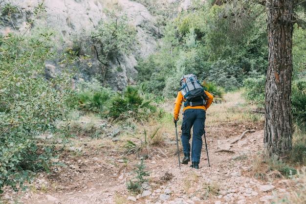 Man trekking in mountains Free Photo