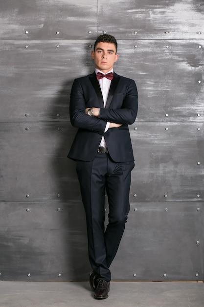Man in tuxedo in studio Free Photo