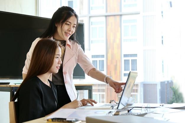 Man typing keyboard laptop hand. business team working startup modern office Premium Photo