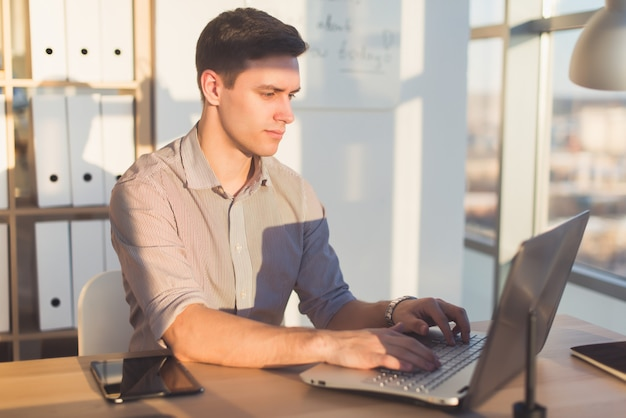 Man typing text or blog in office, hir workplace, using pc keyboard. busyman working. Premium Photo