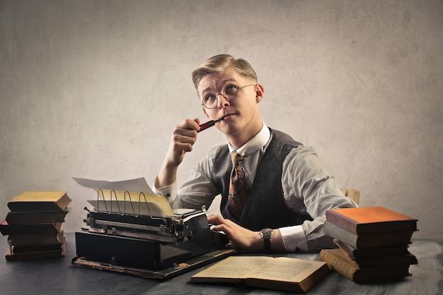 Man use a typewrite Premium Photo