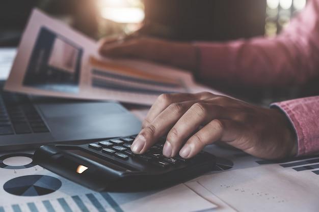 Man using calculator Premium Photo