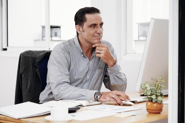 Man using computer at office Free Photo
