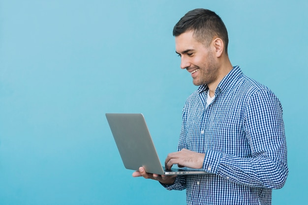 Man using laptop Free Photo