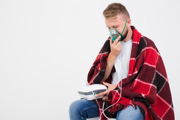 Man using nebulizer for asthma Free Photo