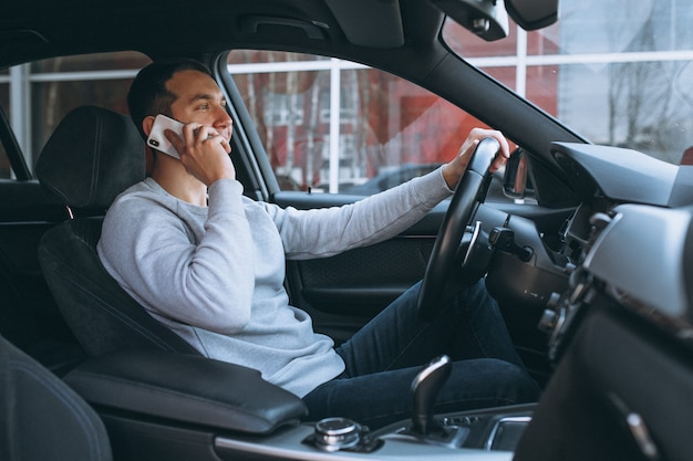 Man using phone while driving Free Photo