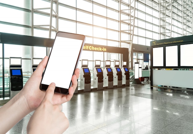 Man using smart phone mobile in the airport terminal Premium Photo